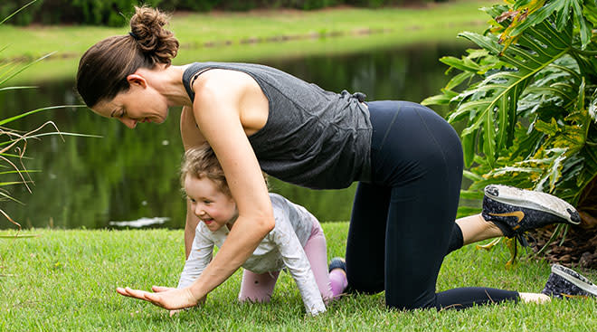 Exercise contributor exercising outside with her toddler daughter.