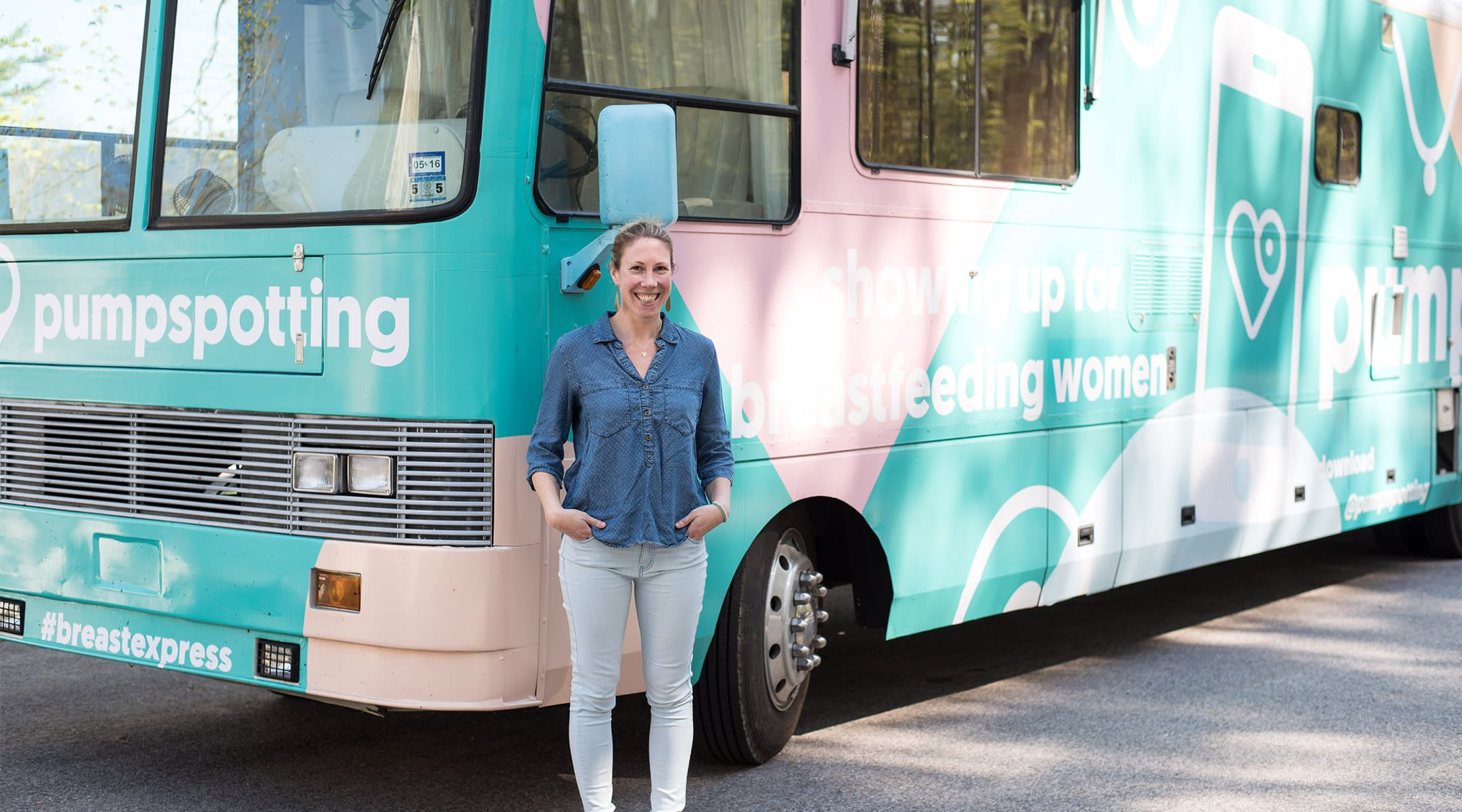 Amy VanHaren in front of a breastfeeding-themed RV