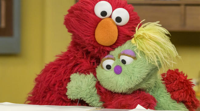 sesame street characters hugging, sesame street launches initiatives to support foster children