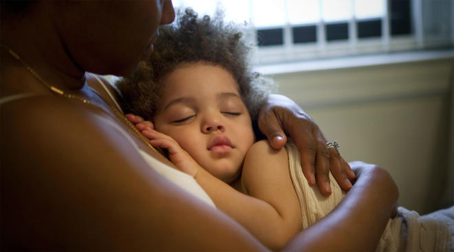 mom soothes her toddler at night after a nightmare