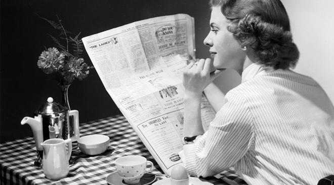 retro woman reading the newspaper