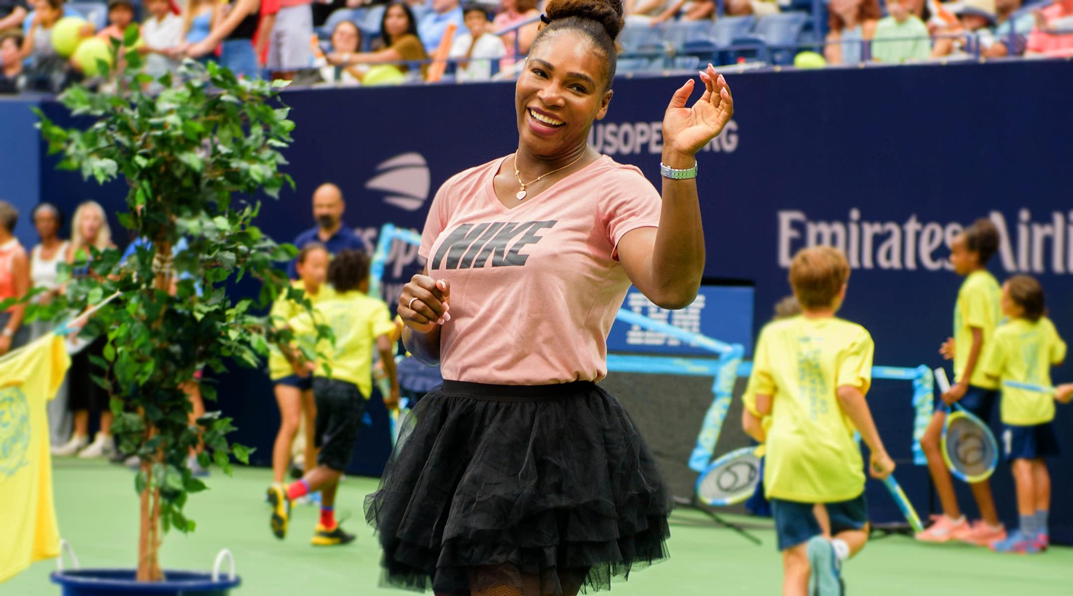 serena williams at tennis match laughing and wearing tutu