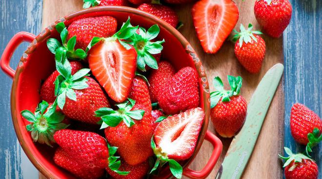 strawberries on a cutting board