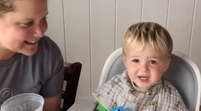 video still of Amy Schumer's son saying dad for the first time.