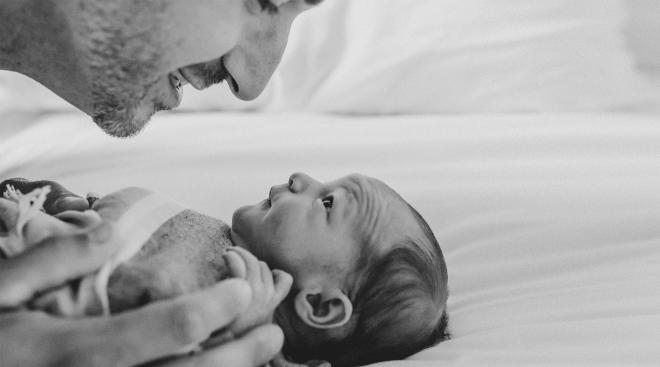 close-up of dad singing to his newborn baby