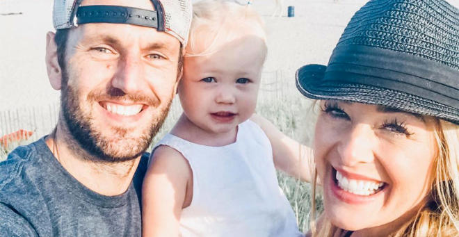jamie otis with her husband and daughter at the beach