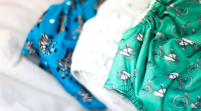 three cloth diapers with various print patterns