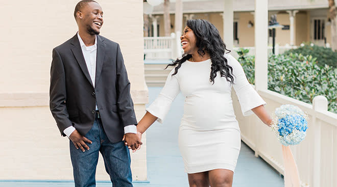 pregnant woman laughing with her partner