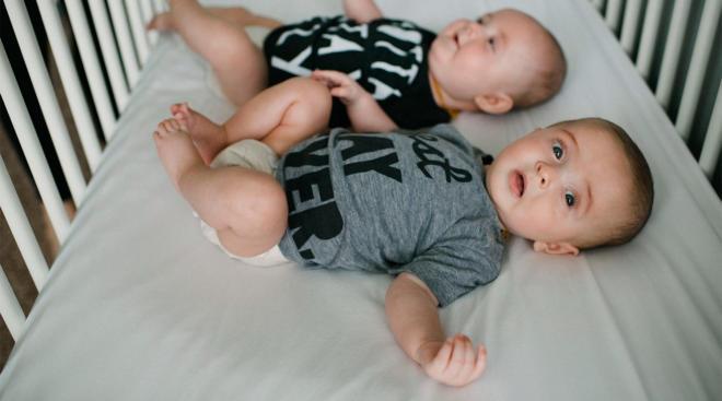 twins in their crib
