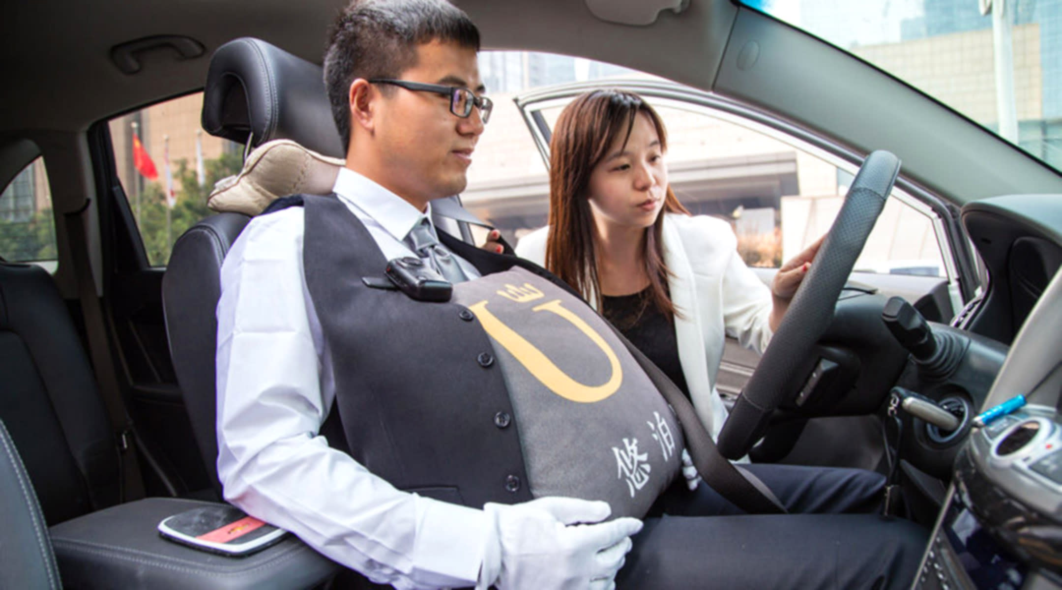 chinese valet drivers wear pregnancy bellies for sensitivity training