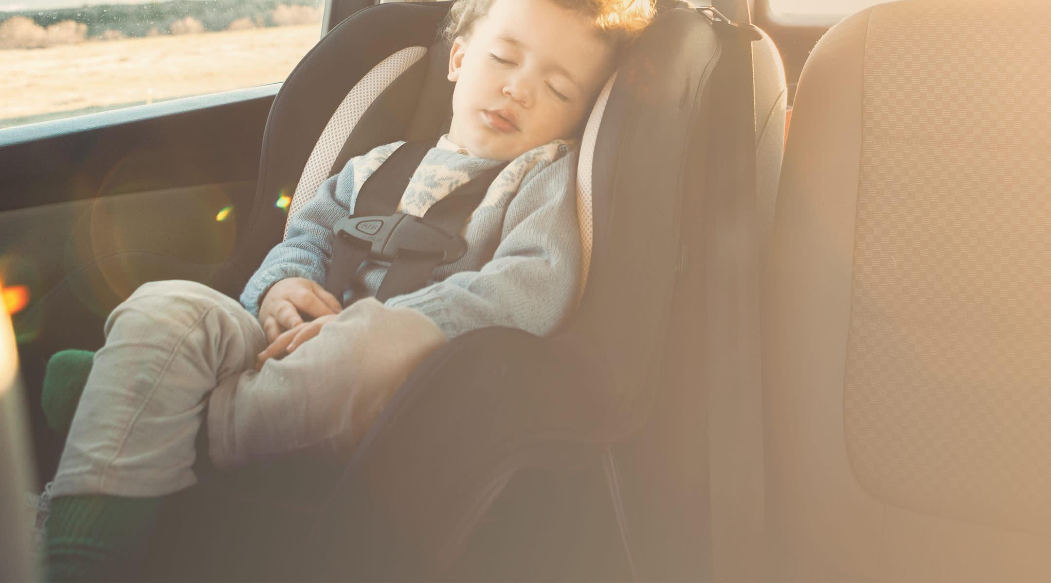 toddler sleeping in hot car