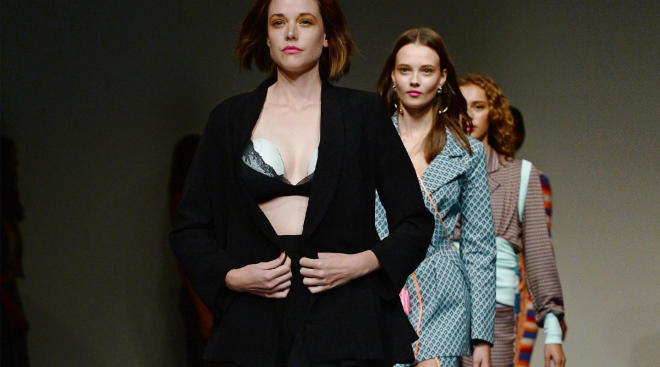 model walks fashion show with breast pump in her bra