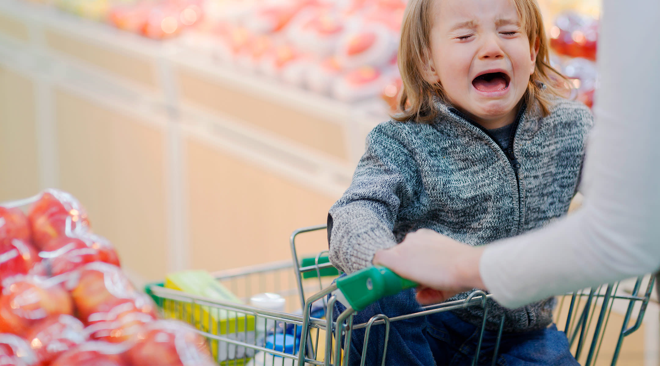 toddler having a tantrum in the grocery store