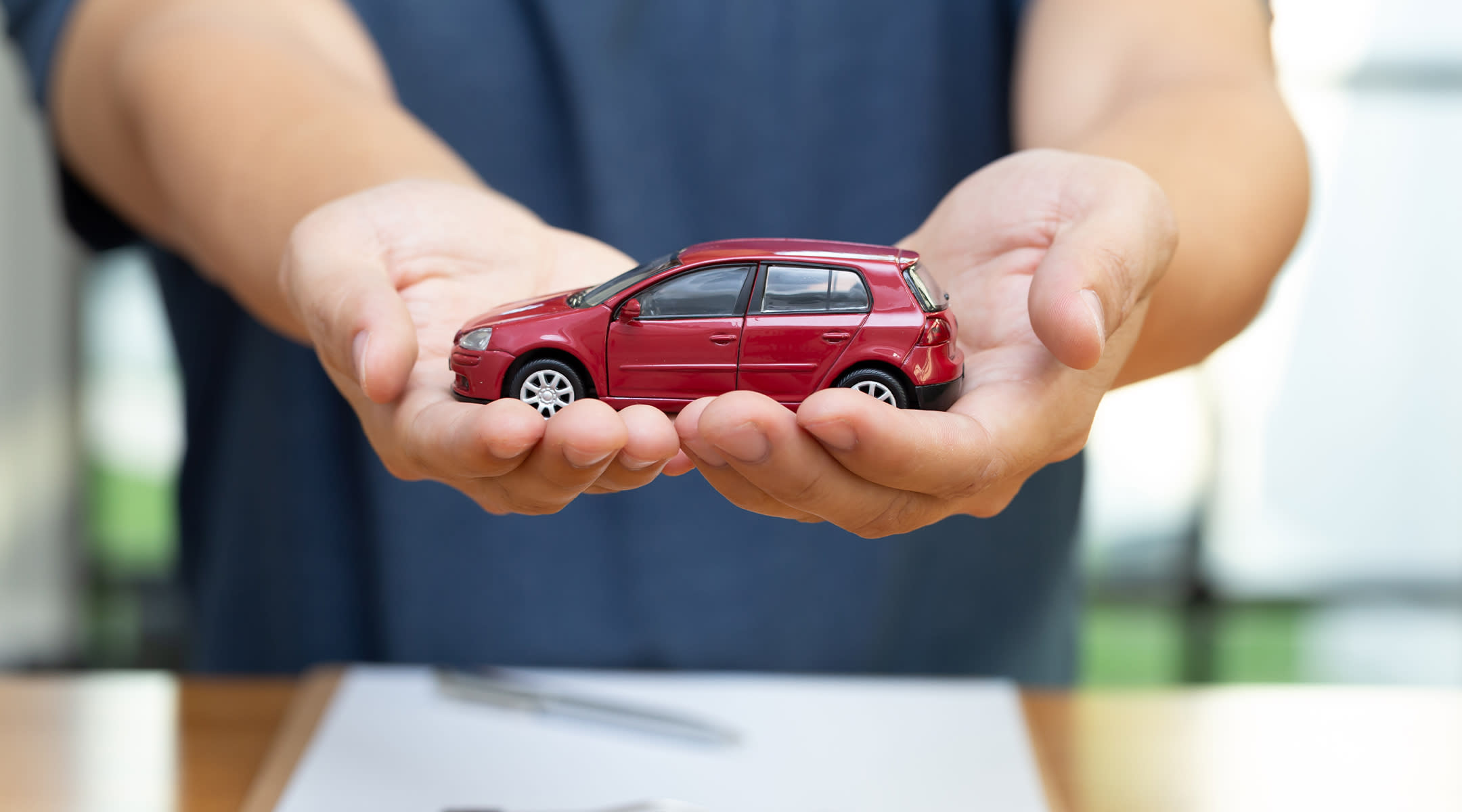 person holding toy car