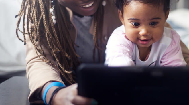 Toddler having screen time with mom