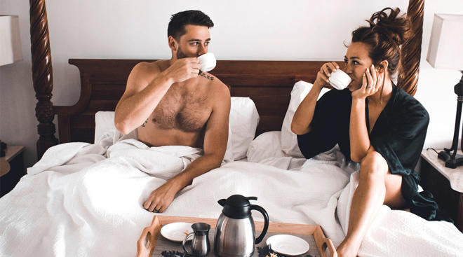 couple having coffee in bed together