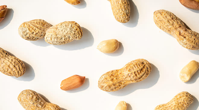 Overhead view of peanuts in their shell and also shelled.