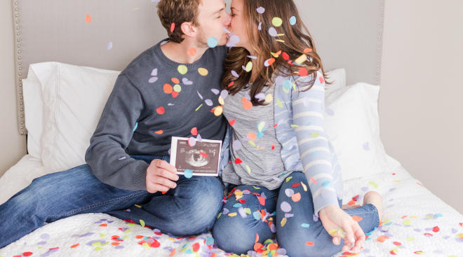spring pregnancy announcement couple using pastel confetti while holding sonagram