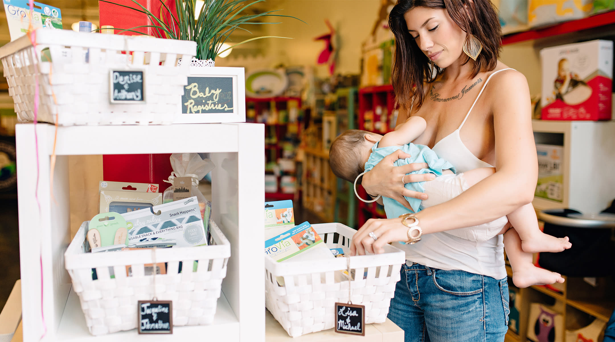 mom breastfeeding shopping public baby