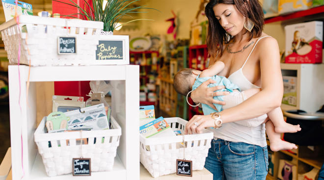 mom breastfeeding shopping public baby