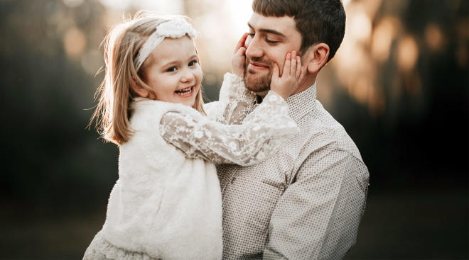happy little girl making her dad smile