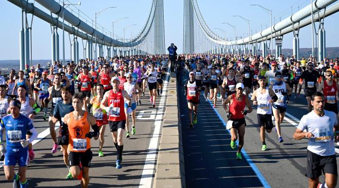 many runners at the start of the new york marathon on the verrazano bridge