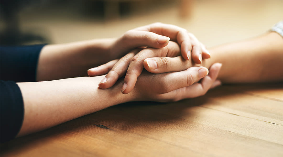 couple holding hands across a table
