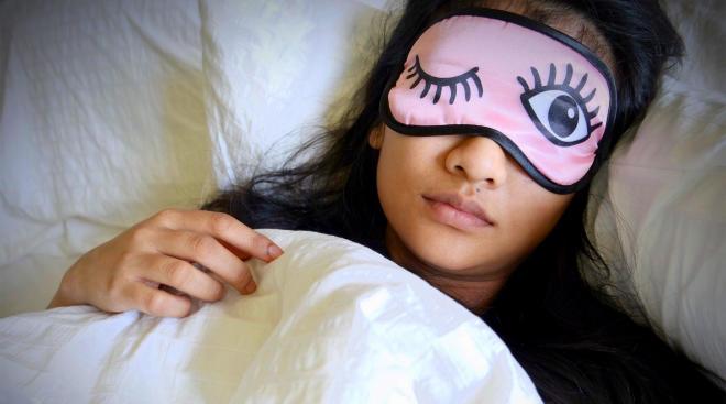 tired mom sleeping with funny sleep mask