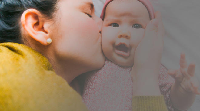 mom soothing baby during 4 month wakeful period
