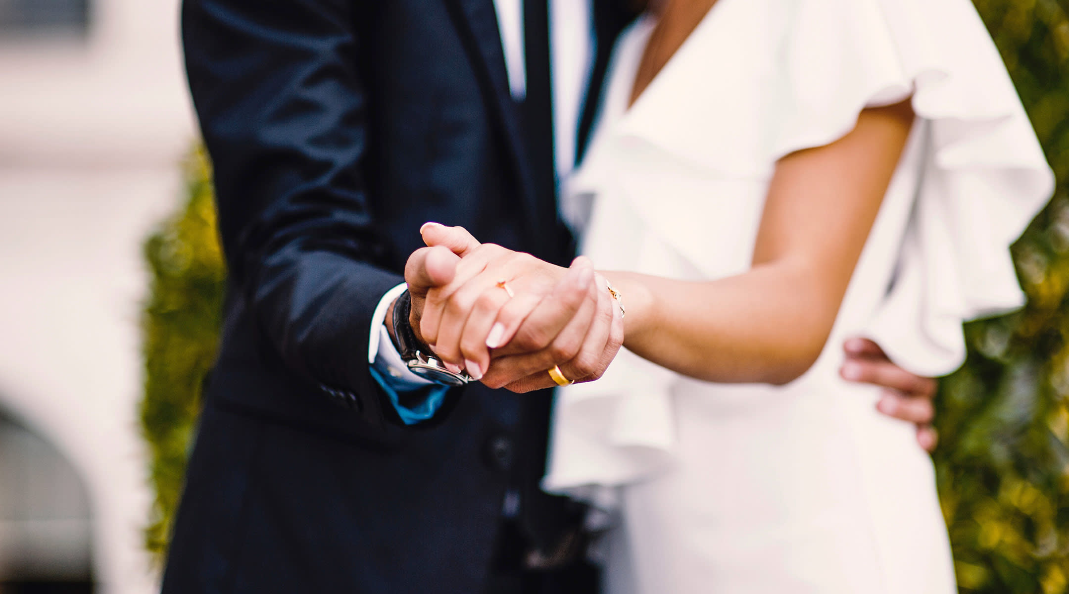 photo of couple's hands on their wedding day