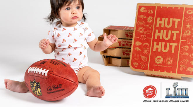 baby pictured with pizza hut boxes for deal pizza hut is offering, free pizza for one year first baby born after kick off