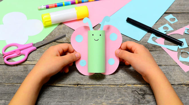 child creating crafts using a glue stick