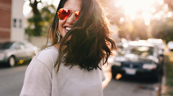 happy woman with hair flowing in the wind