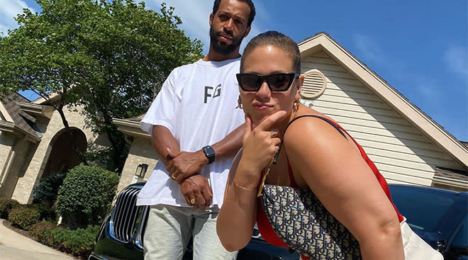 Ashley Graham and her husband Justin Ervin outside their house