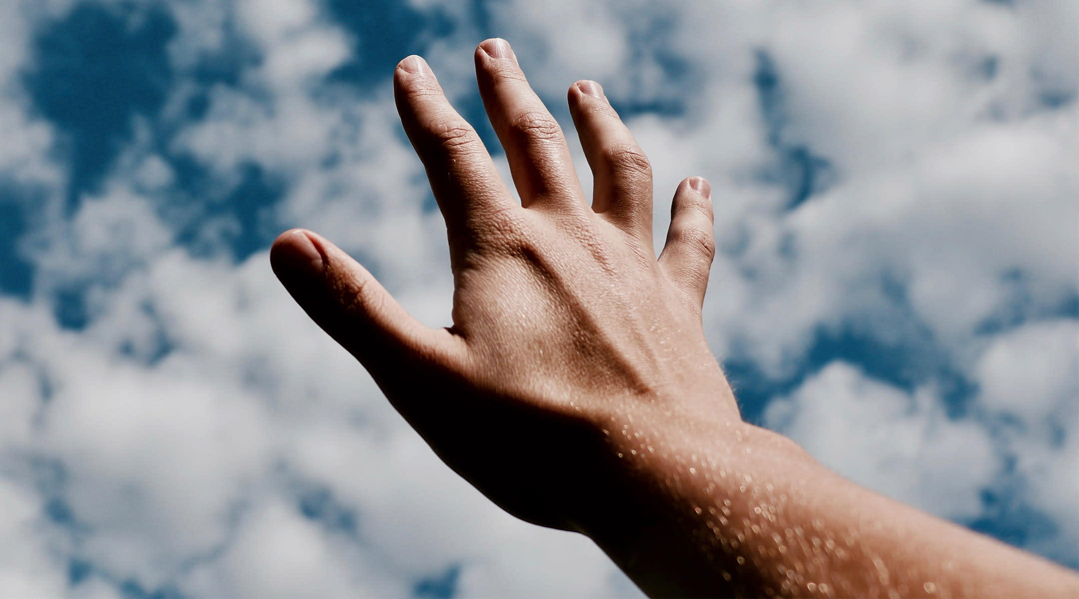 hand reaching out in the sky