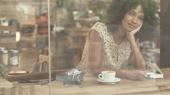 woman reflecting in cafe