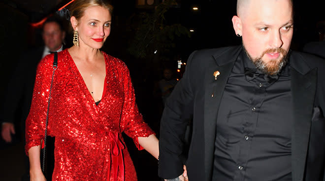 cameron diaz in red dress walking with husband benji madden