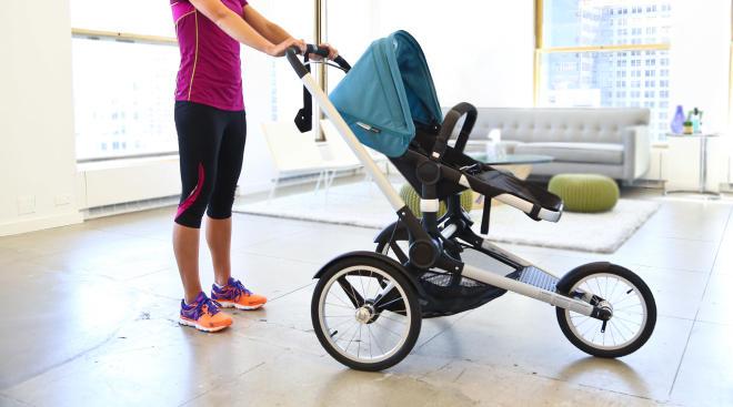 woman pushing jogger stroller