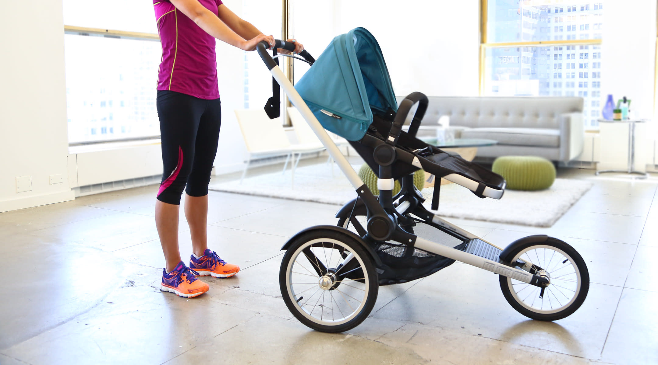 woman pushing jogger stroller