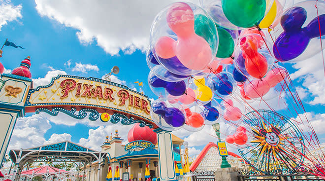 Scene from Disney Land with colorful balloons.