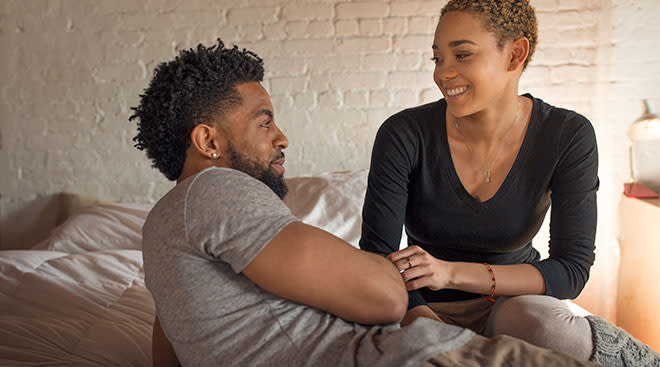 couple in their bed talking