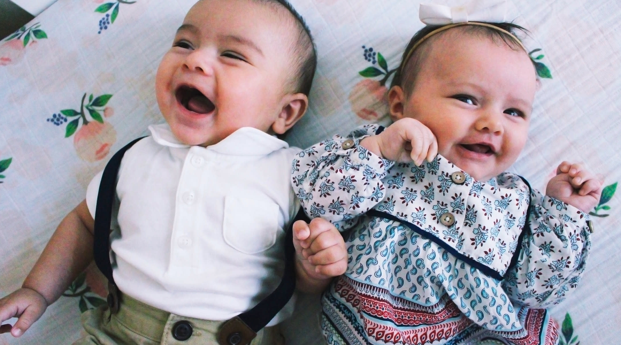 babies laughing and talking to each other