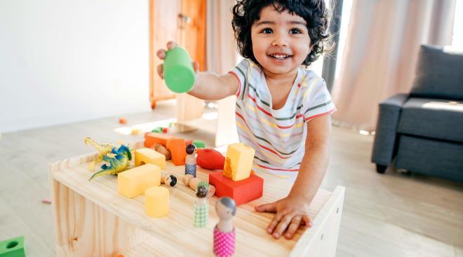 toddler playing stem toy blocks