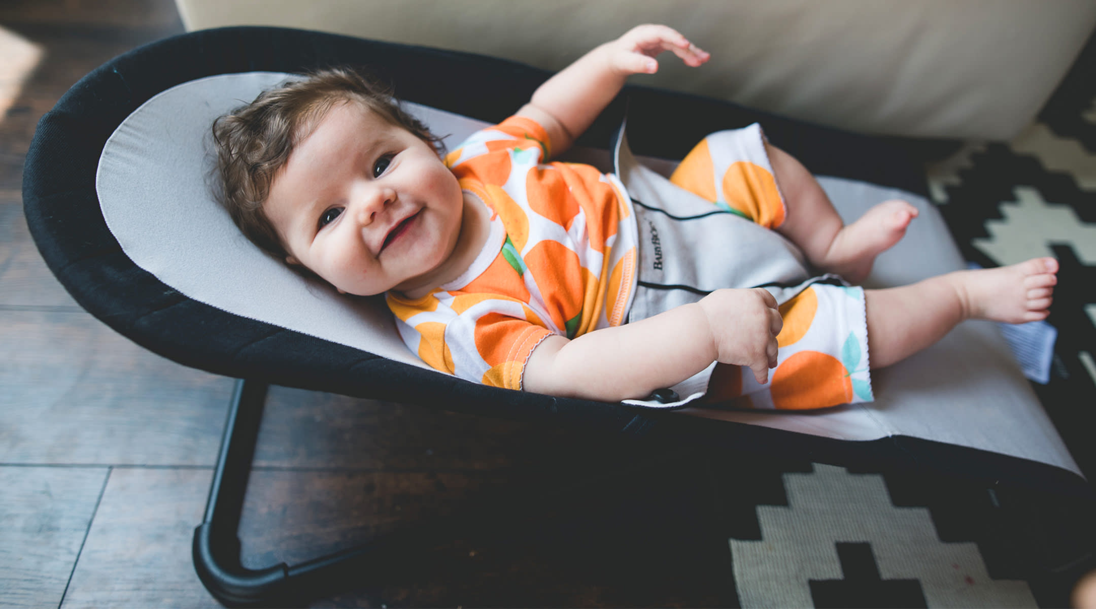 happy baby in baby bouncer