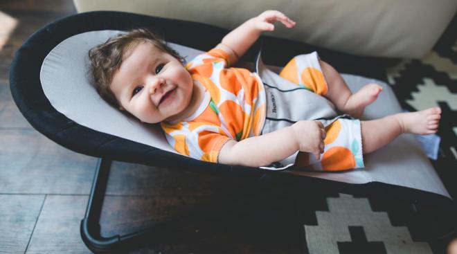 happy baby in baby bouncer