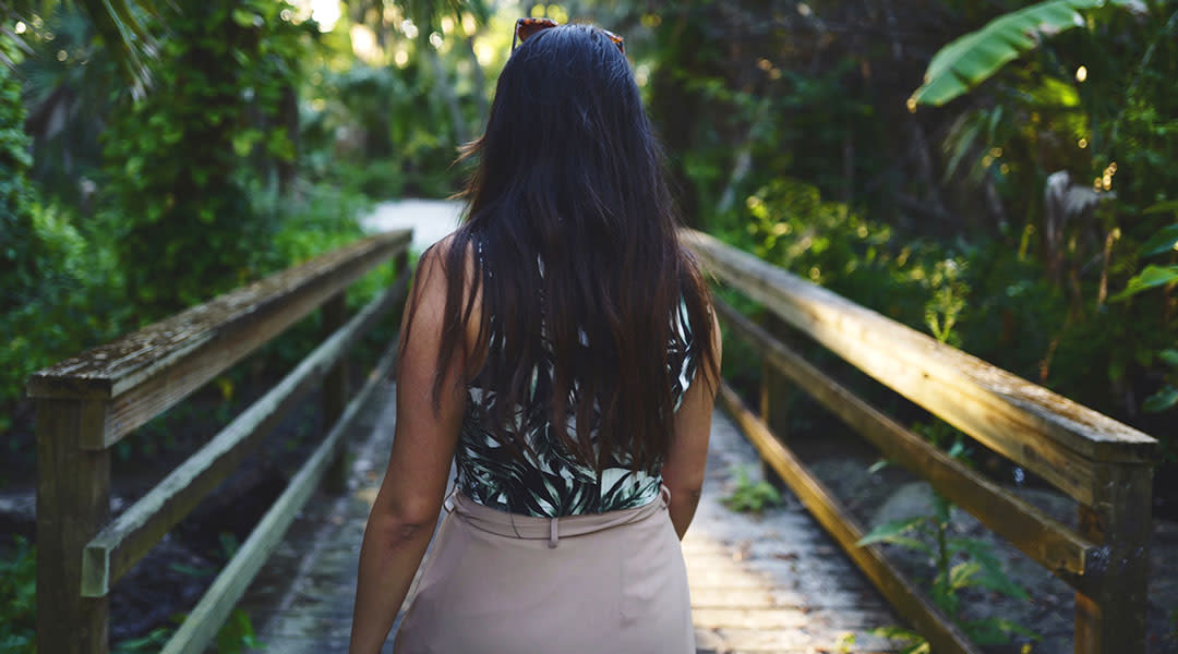 woman walking outside in tropical environment