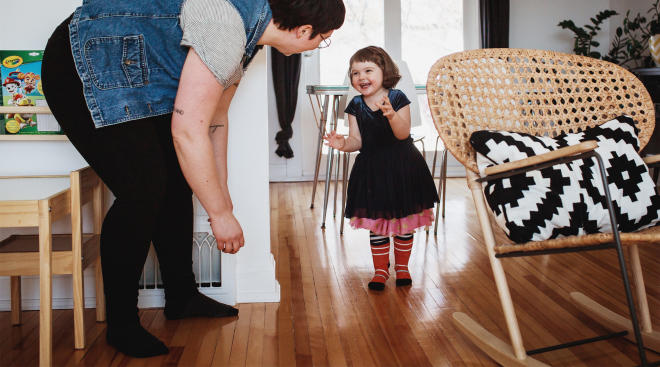 happy toddler talking to her parent