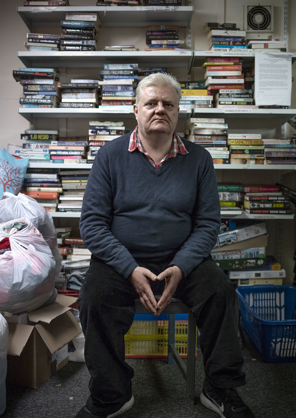 Gerry, a volunteer at a Shelter Scotland shop. Photographed for Shelter Scotland's 50th anniversary by Melissa Mitchell.