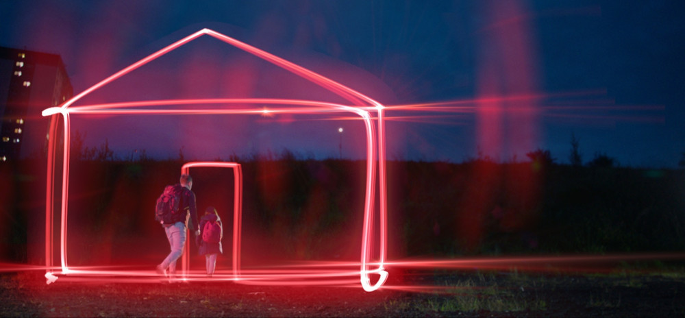 neon lights house - father and daughter going through the doorway