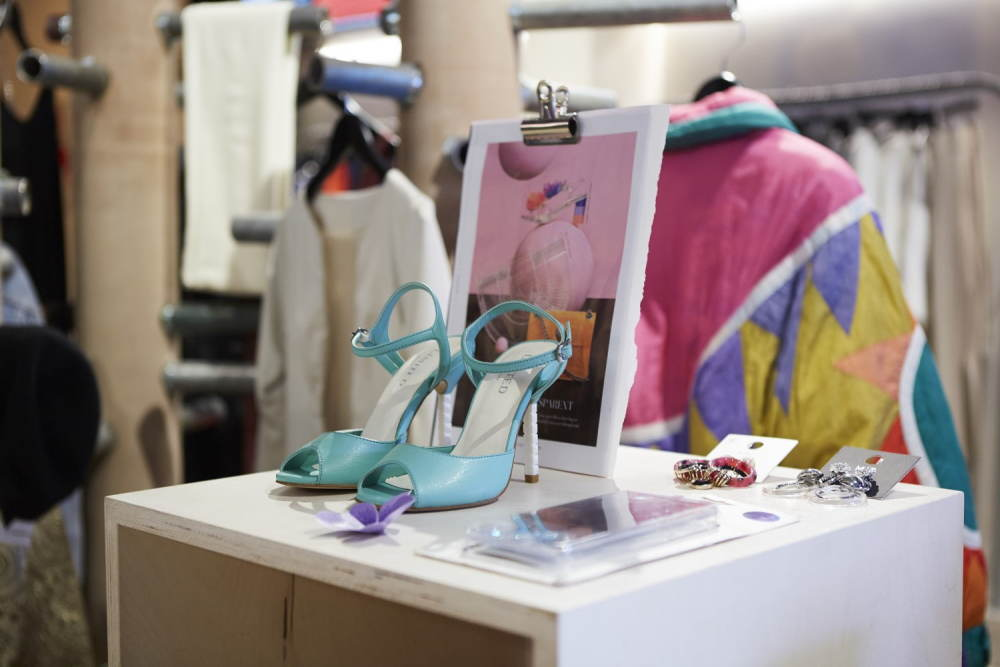 A pair of blue high heels in a Shelter shop display